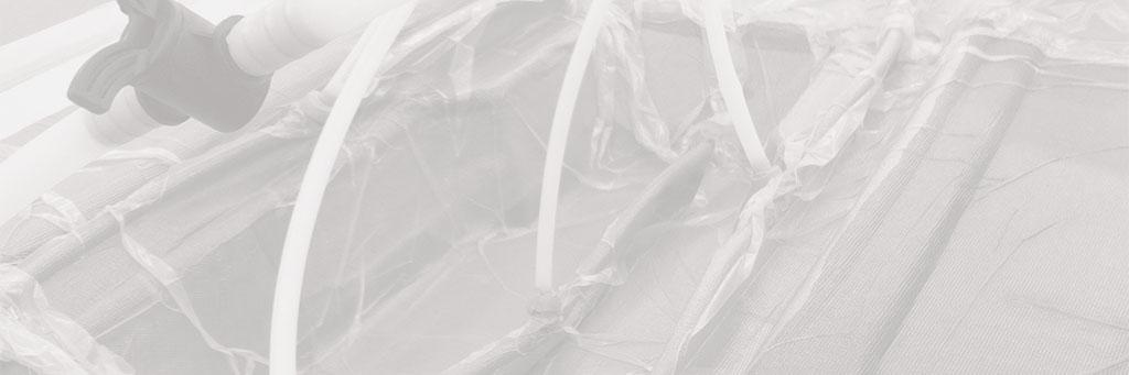 Infusion de matériau composite grâce à des tuyaux